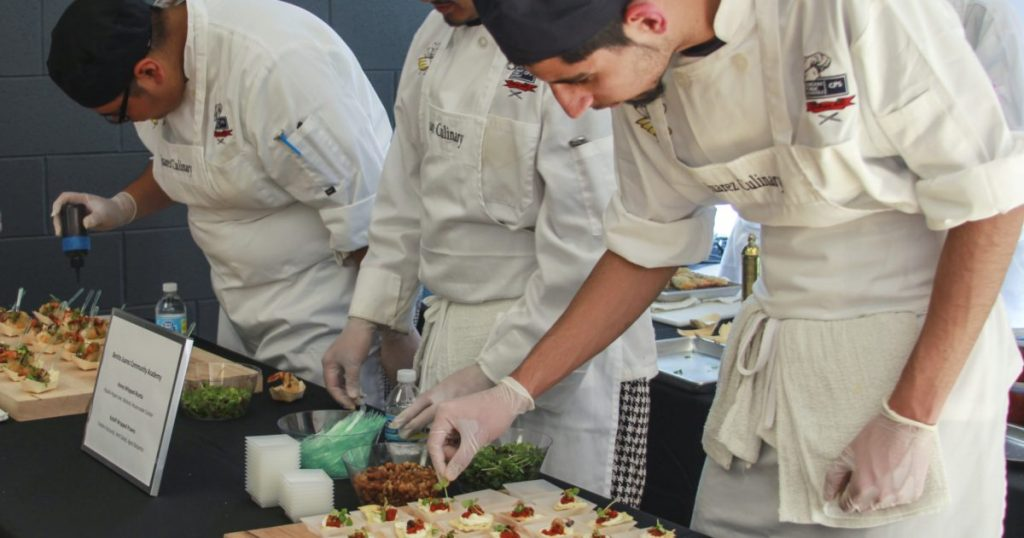 CPS students from Juarez HS prepare food at a gala event.